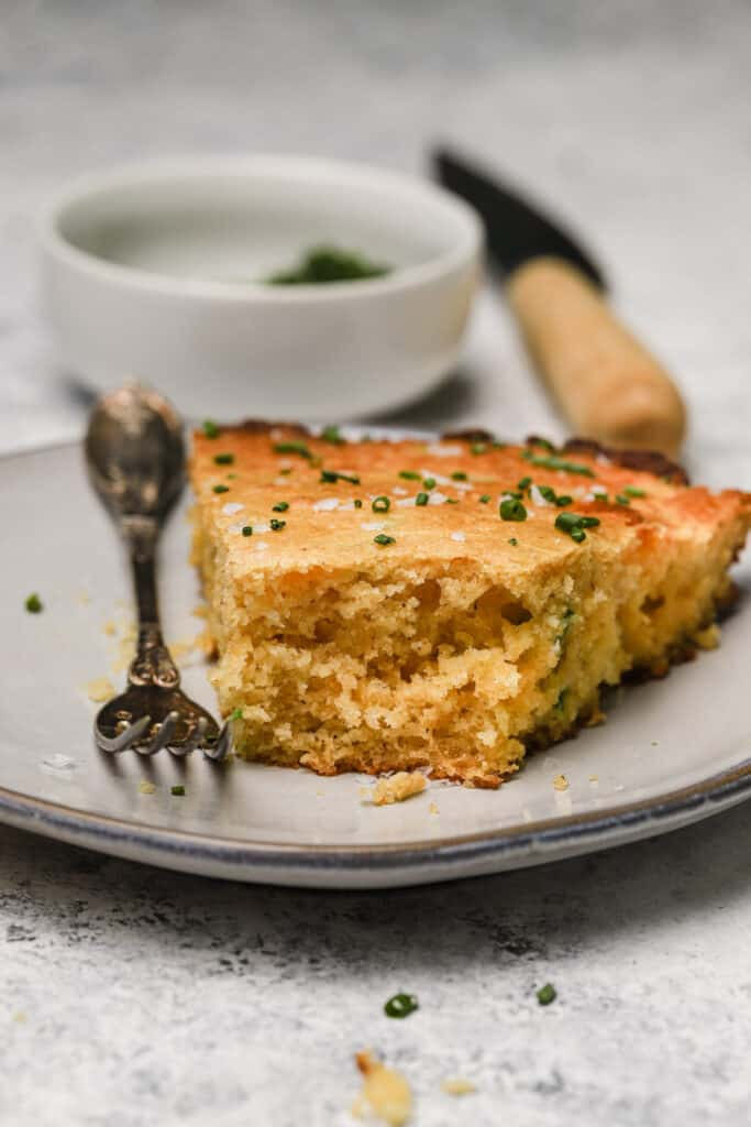 cornbread on a plate with flaky sea salt