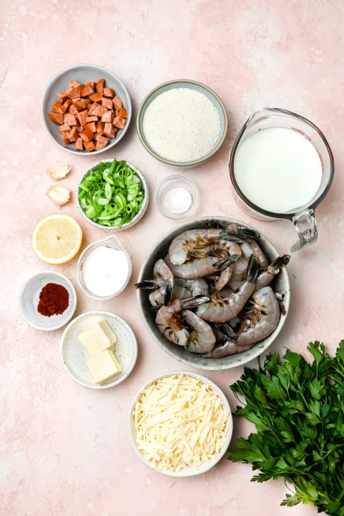 Ingredients for shrimp and grits on a board