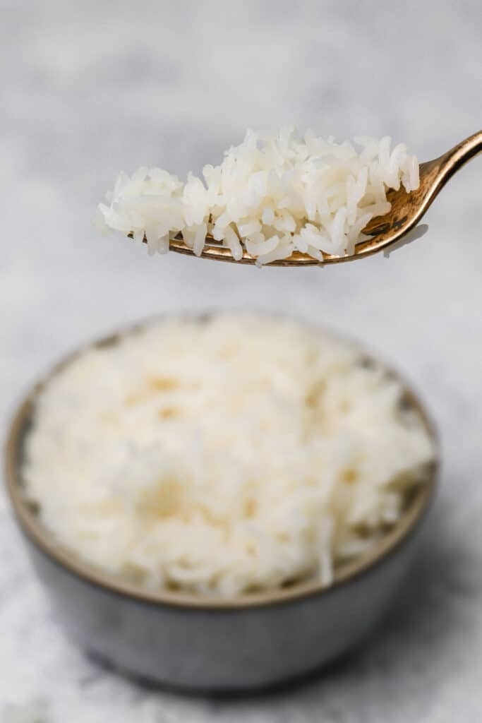 Instant pot basmati rice on a gold fork