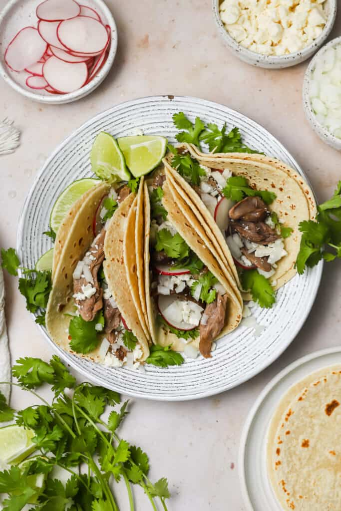 Lamb tacos with onion and cotija