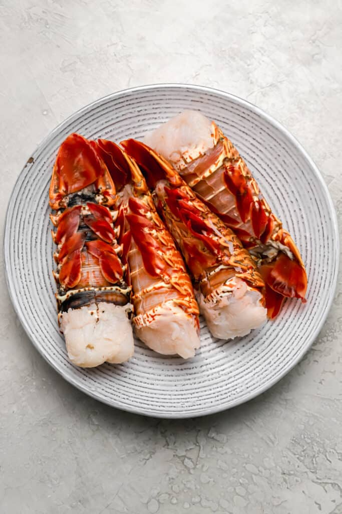 Lobster tail shells cut on a plate