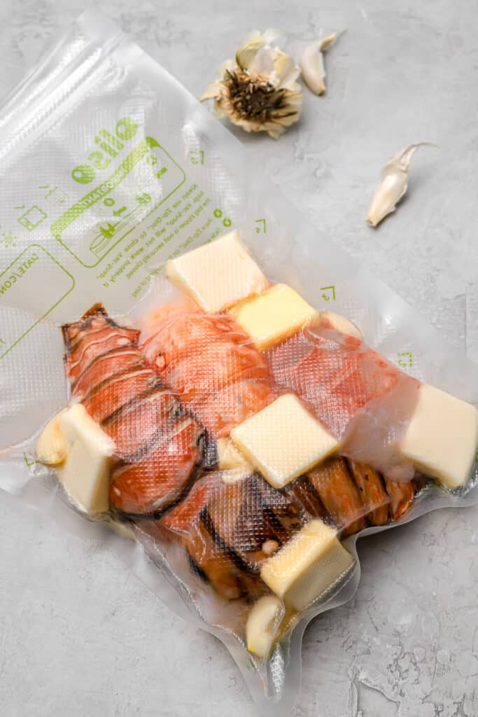Lobster tails with butter and garlic in a vacuum seal bag