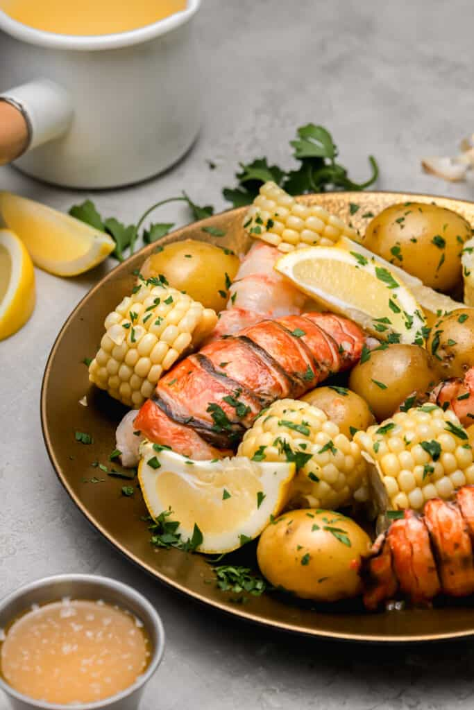 Lobster tails with corn lemons and potatoes