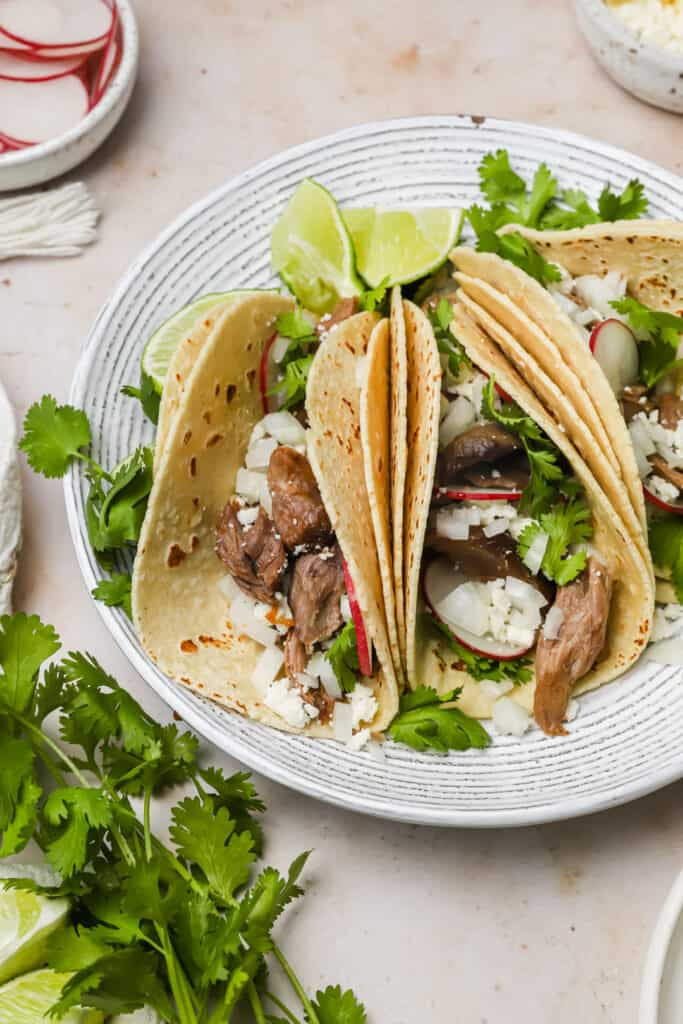 Shredded lamb tacos on a plate