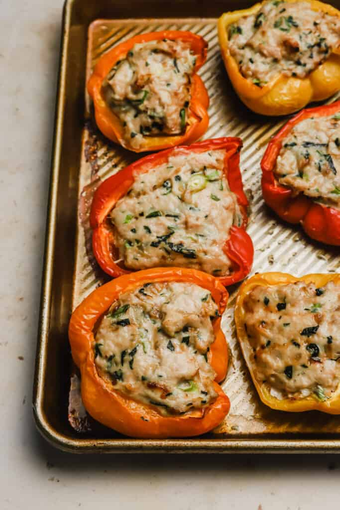 Baked Asian stuffed peppers on a baking sheet