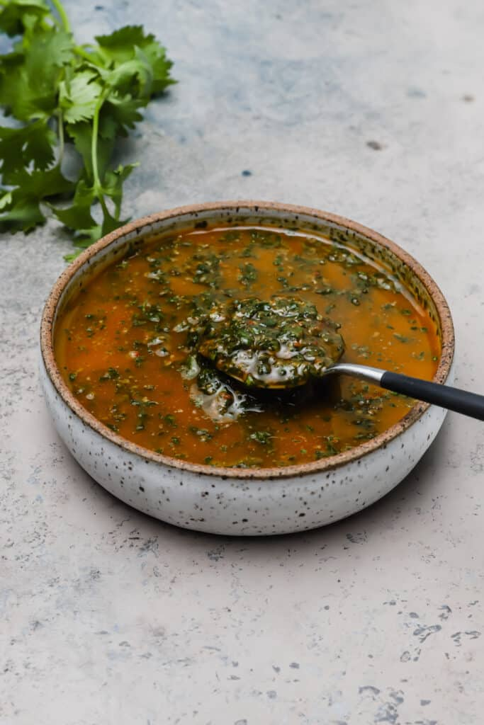 Chermoula sauce in a bowl with a spoon