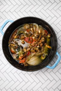 Cooked shellfish stock in a large pot