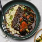 Flanken short ribs with mashed potatoes on a plate
