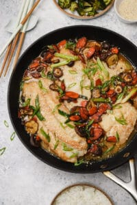 Miso cod in a skillet with scallions