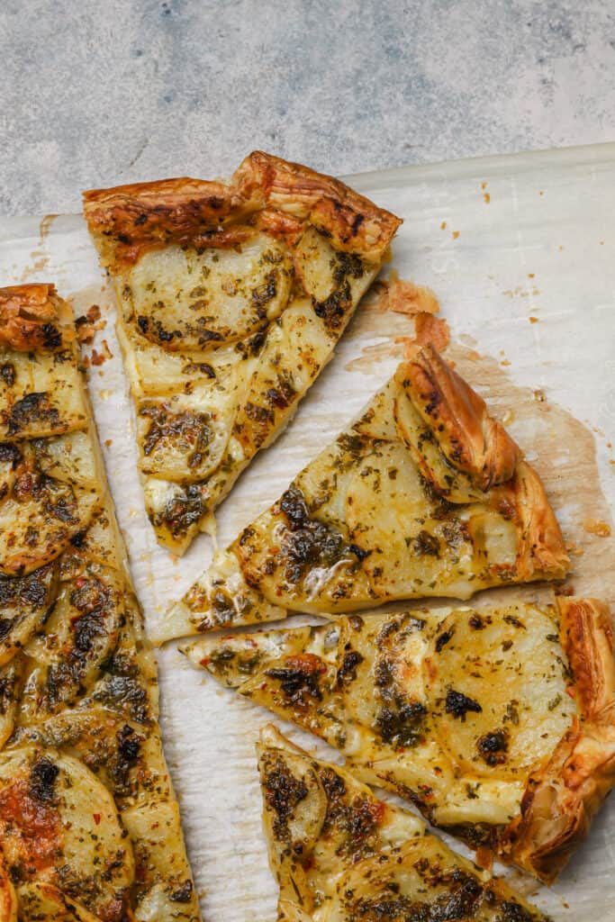 Sliced cheesy galette with chermoula potatoes