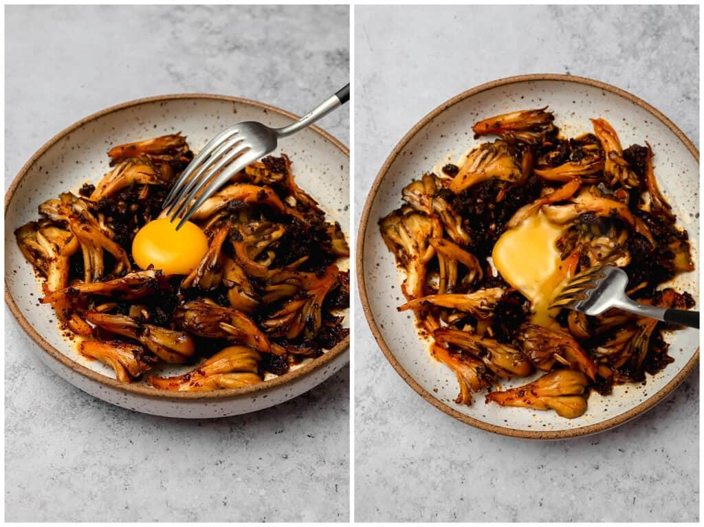 Breaking an egg yolk over maitake mushrooms