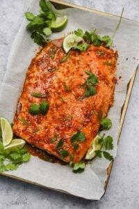 Cooked chili bourbon glazed salmon on a sheet pan