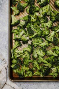 Raw broccoli on a baking sheet