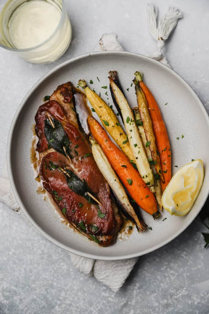 Saltimbocca on a plate with carrots