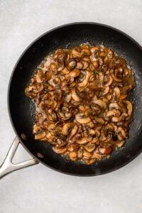 Sautéed mushrooms in a skillet with marsala