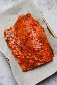 Side of salmon with chili bourbon glaze on a baking sheet
