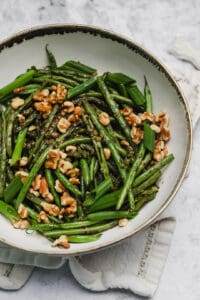 Close up of sautéed string beans with capers and anchovies
