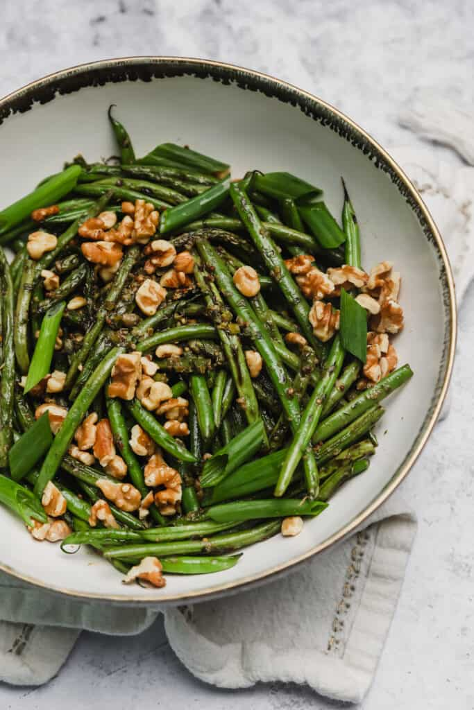 Close up of sautéed French green beans with capers and anchovies