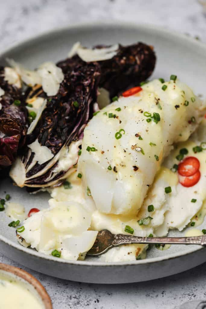Flaky poached cod on a plate