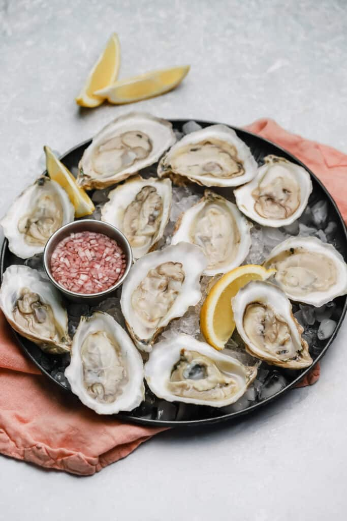 Oysters on the half shell with mignonette over ice