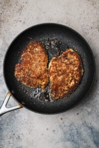 Pan fried breaded chicken in a skillet