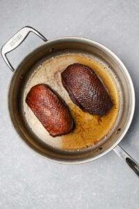 Seared duck in a pan