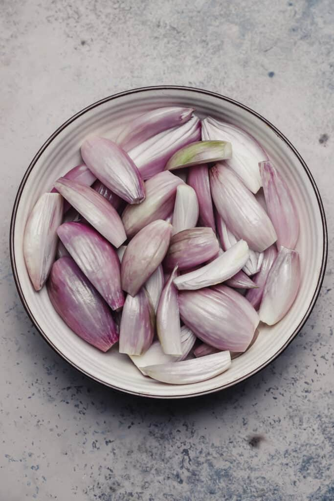 Trimmed shallots in a bowl