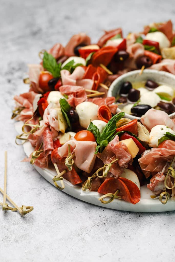 Close up of antipasto with basil on a tray