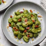 Creamy kale gnocchi on a plate with pancetta