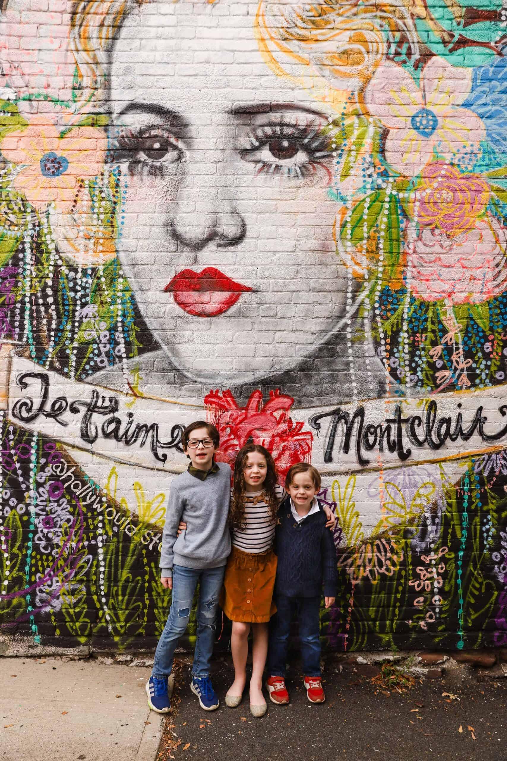 Kids in front of Montclair mural