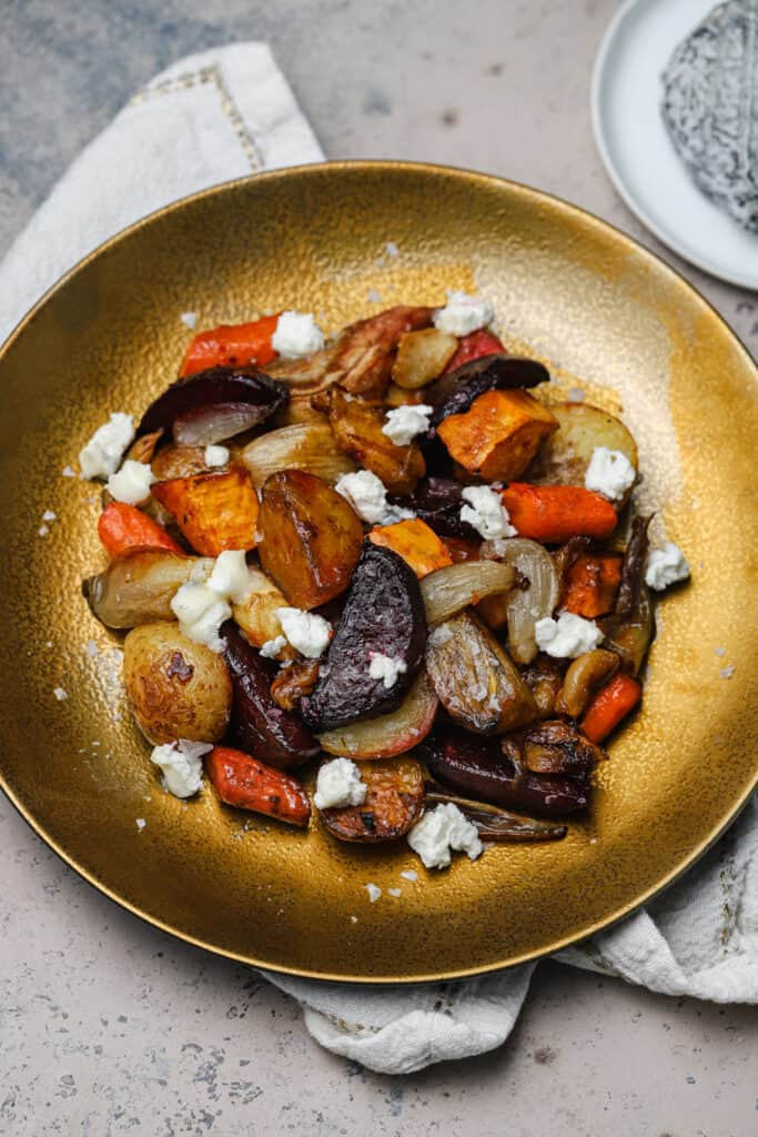 Close up of root veggies roasted with crumbled goat cheese