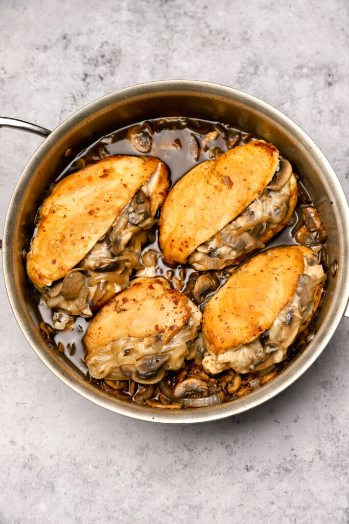 Chicken marsala in a pan before baking