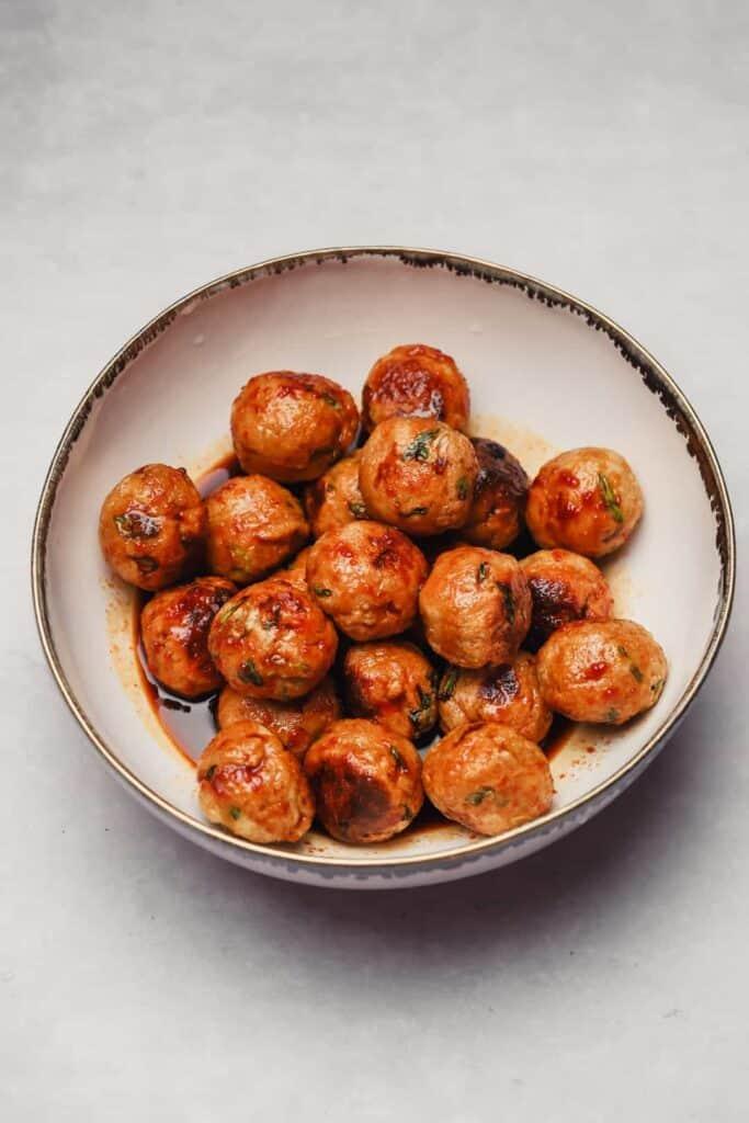 Gochujang chicken meatballs in sauce in a bowl