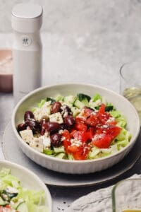 Greek salad over romaine lettuce