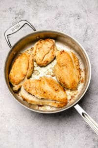 Seared chicken breasts in a skillet
