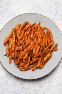 Seasoned sweet potato wedges on a plate