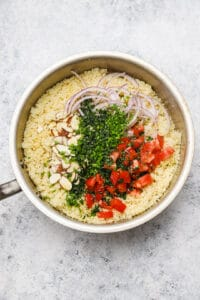 Adding vinaigrette to couscous salad