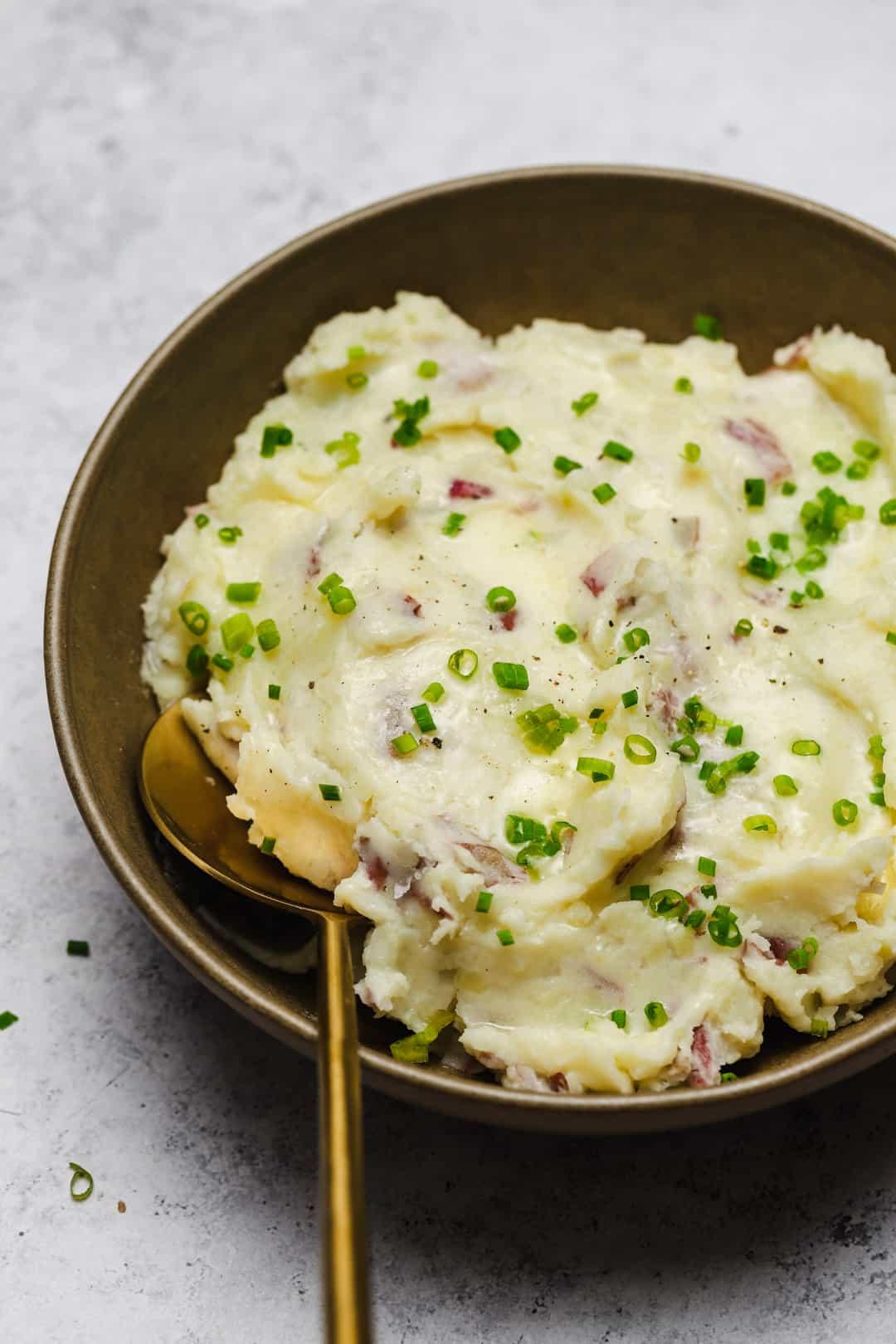 Close up of mashed potatoes in a gold bowl