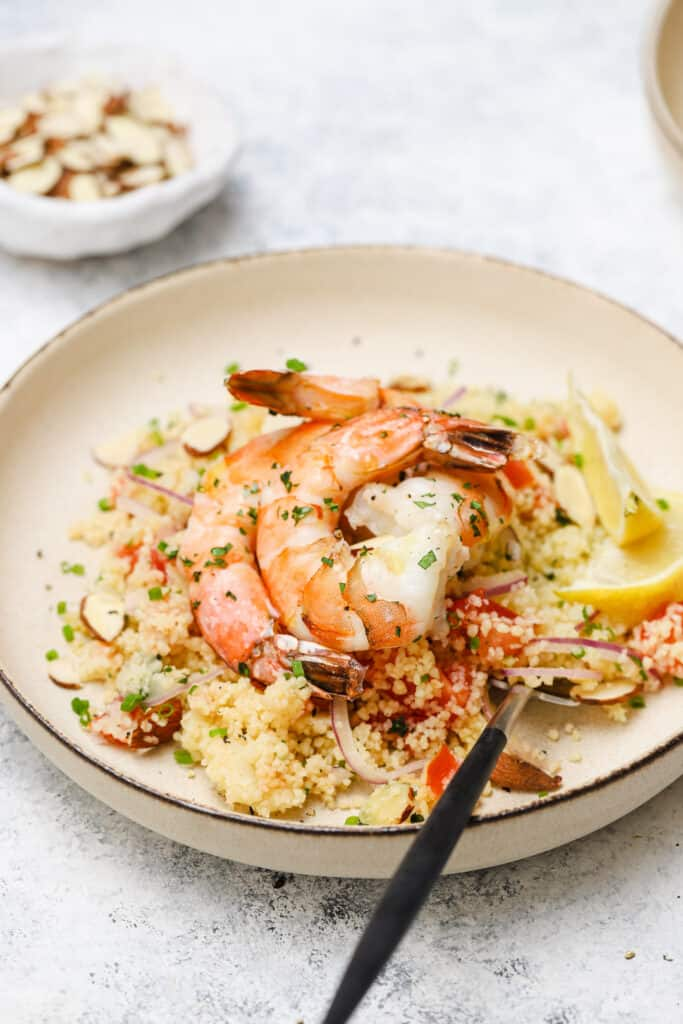 Couscous with tarragon roast shrimp in a bowl