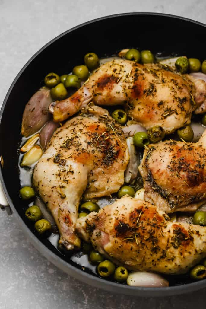 Herbs de provence chicken with olives in a pan