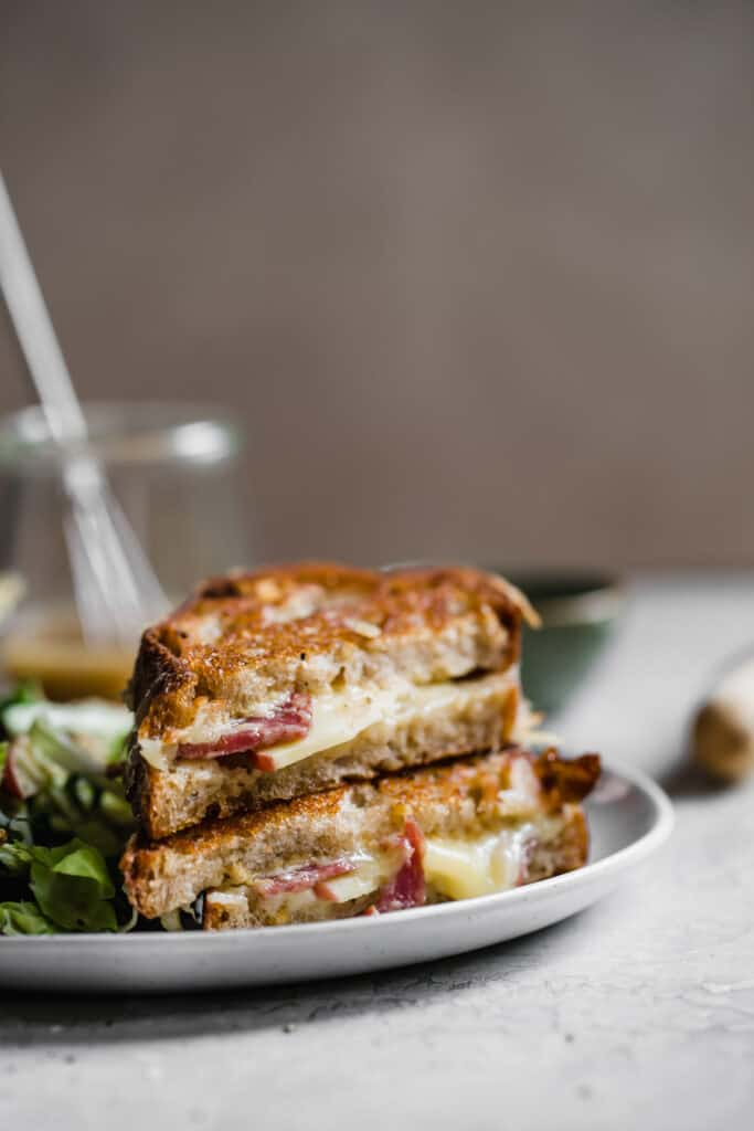Melty grilled cheese stacked on a plate