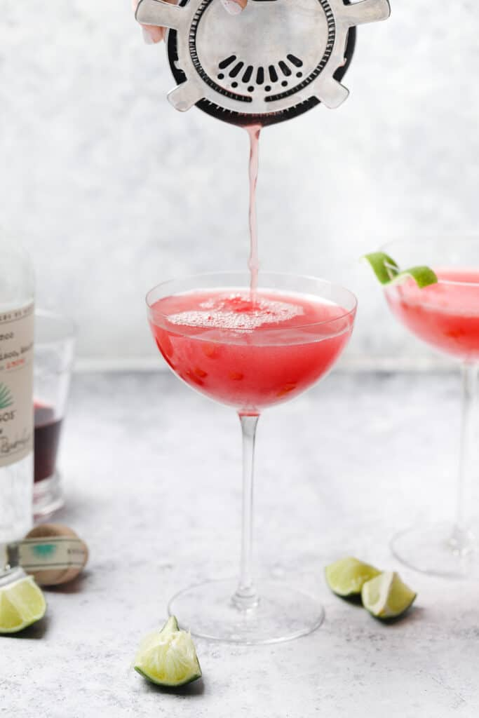 Pouring tequila cocktail