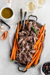 Pulled leg of lamb on a tray