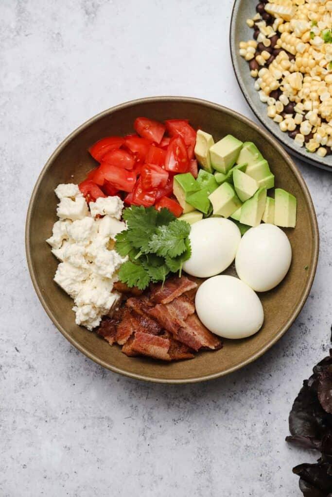 Cobb salad ingredients in a bowl