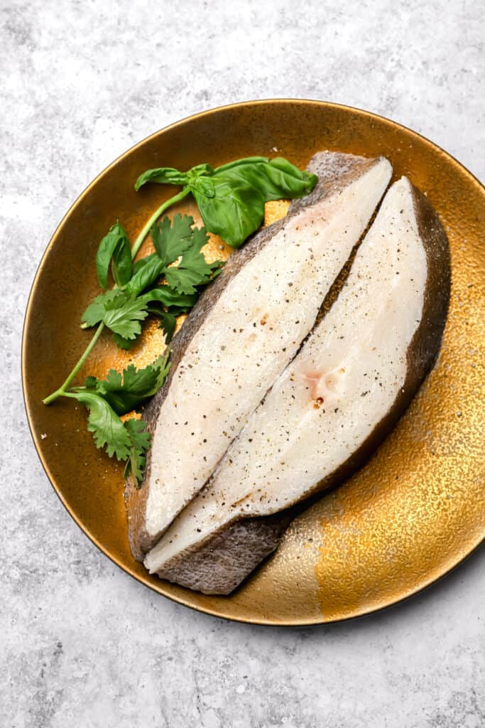 Halibut steaks with salt and pepper