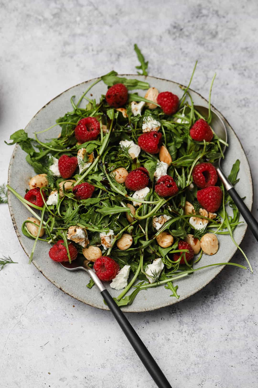 Arugula salad with marcona almonds and raspberries