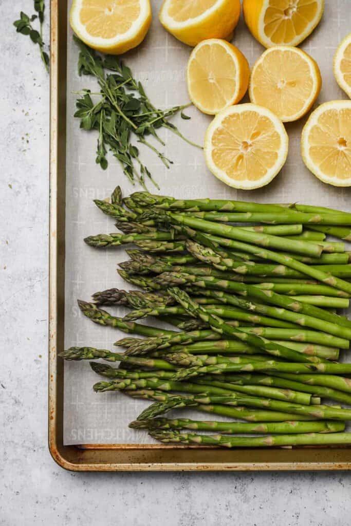 Asparagus and lemon on a tray