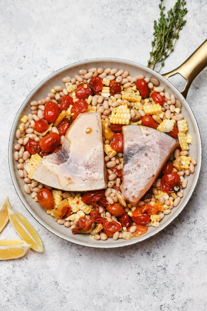 Before baking swordfish with corn and tomatoes