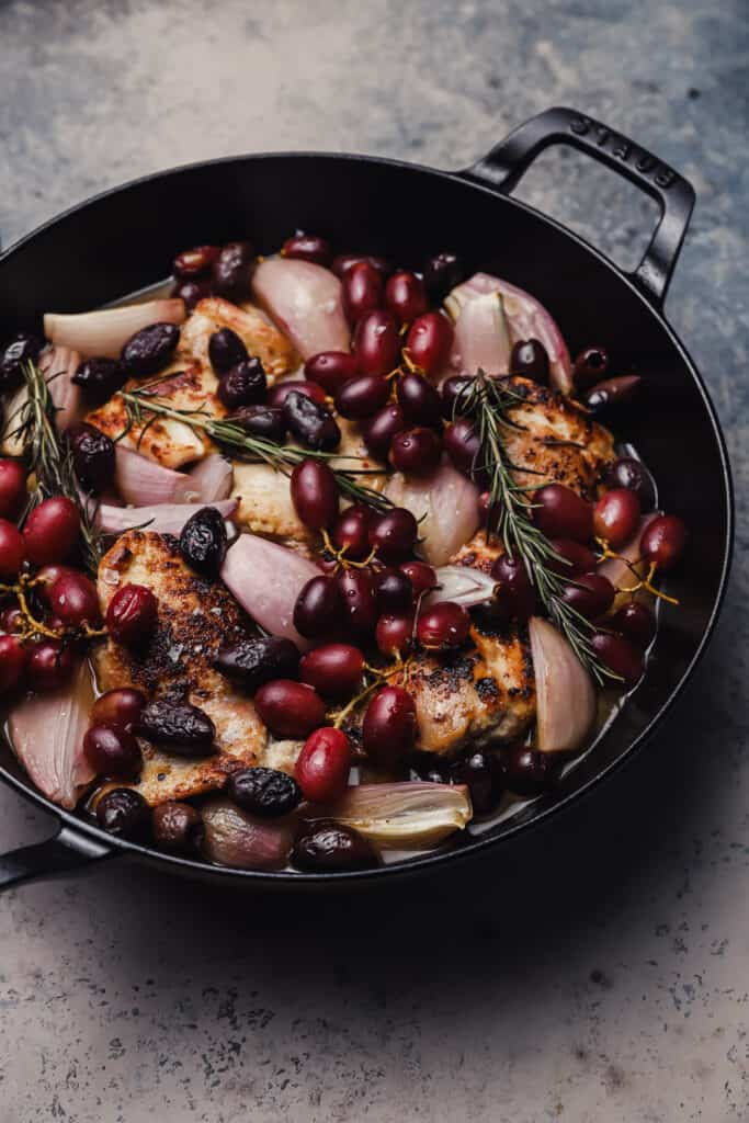 Before roasting grapes and olives with chicken