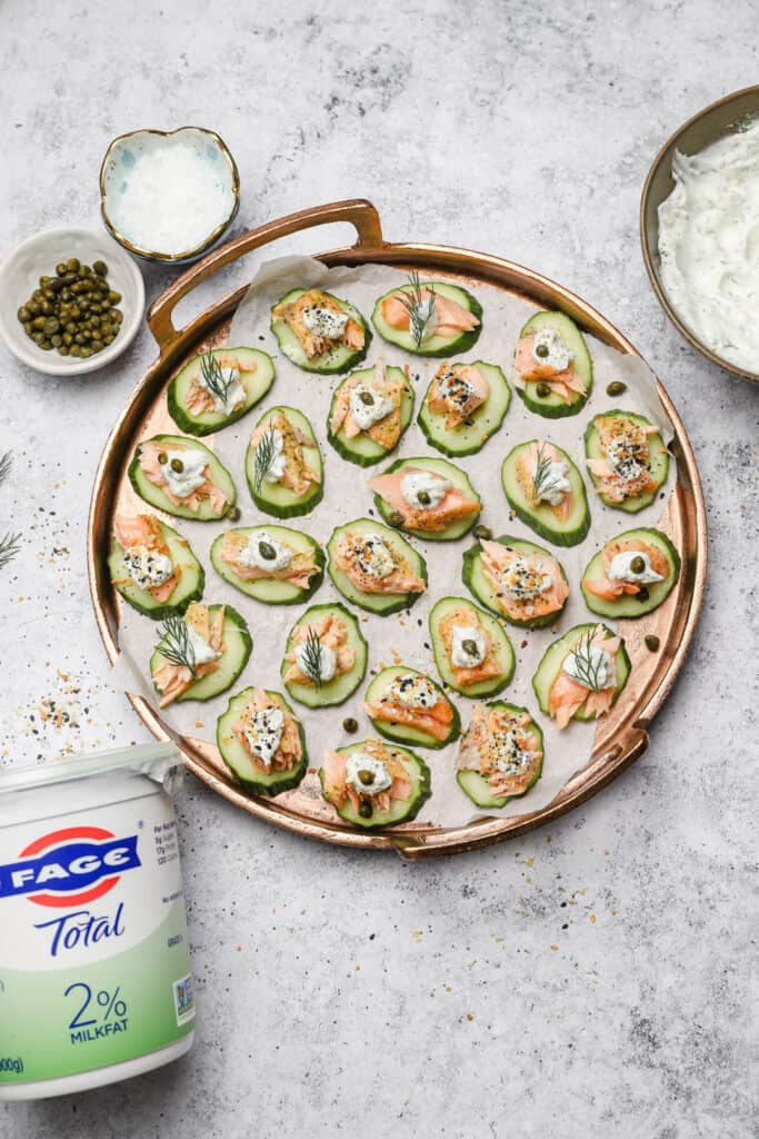 Cucumber slices with Greek yogurt and baked salmon